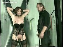Master puts metal clamps on nipples of slave and plays with her tits and pussy bdsm
