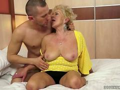 Hot busty granny enjoys a hard fucking by the stallion