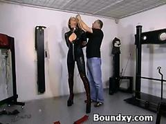 Bondage action with a babe in latex