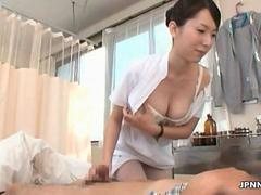 Cute asian nurse jerks a patients wang