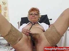 Woolly nurse grannie dildoes her twat