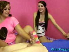 Handjob loving teenagers toying with a cock