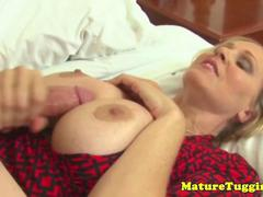 Busty mature milf gets cum on tits after hj