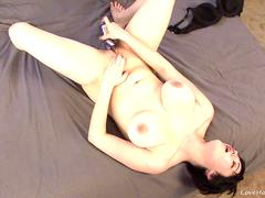 Gorgeous busty brunette masturbating hard on the bed