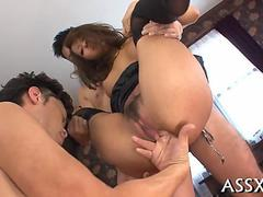Fantastic Japanese babe spread apart and fucked standing by two guys