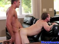 Muscular stud fucking his lover on the couch