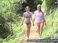 Teen hotties strip each other in a forest for fun