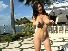 Big ass MILF slowly strips her bikini and teases poolside