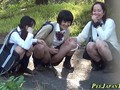 Asian teens piss outdoors