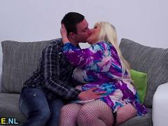 Blonde mature BBW gets nailed by a young guy