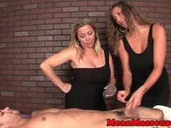 Mean dom masseuses giving rough wankjob