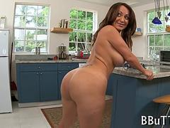 Big tits milf posing in a kitchen butt naked
