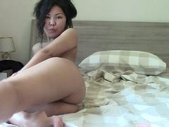 Naughty Asian spreads her legs and masturbates passionately