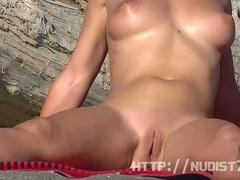 Sexy naked people in a nudist beach spy voyeur video