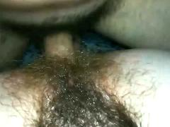 A hunk is licking his wife hairy muff and then put his huge cock in it
