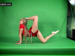 Red Dressed Gymnast Doing Spreads