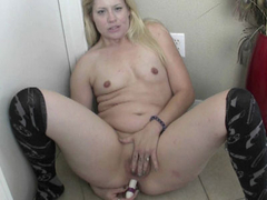 Horny MILF Lisa is banging her sweet ass with a dildo