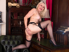 Blonde granny is teasing in sexy lingerie in the office for a webcam
